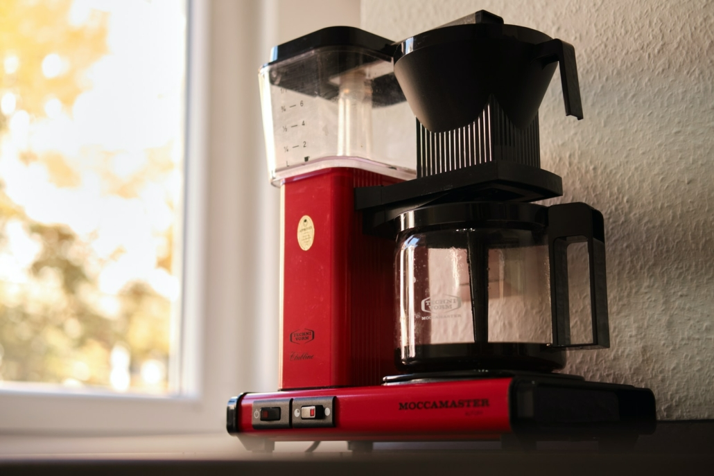 red and black coffee maker
