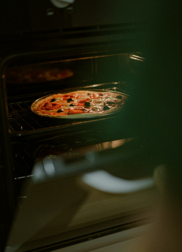 pizza on stainless steel tray